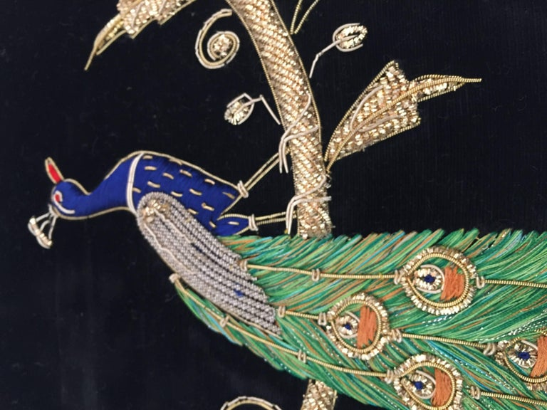 Black silk velvet pillow hand embroidered with gold threads and sequins depicting a royal peacock on a branch. Gold, green, indigo blue and ruby red with turquoise pearl. Handcrafted throw pillow. Silk backed with zipper.