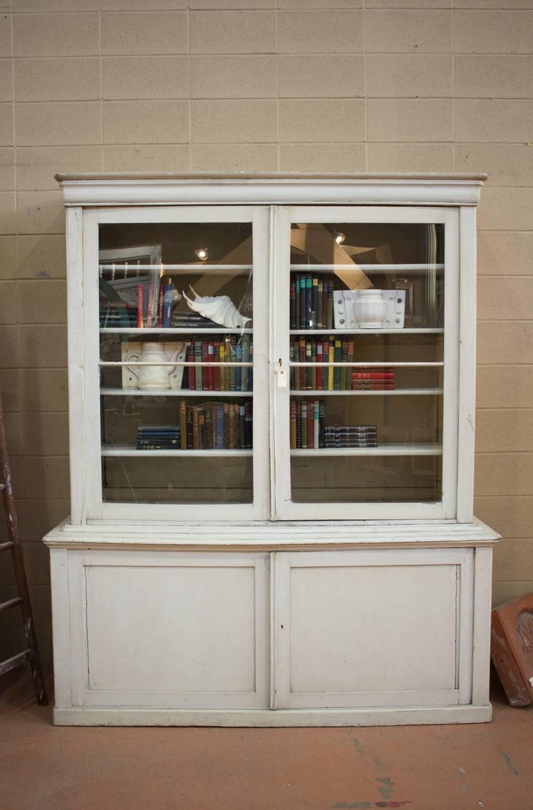 Substantial antique English country-house painted library Bibliotheque. Plenty of upper and lower storage. Would work well in a library or in a kitchen for crockery and glassware.