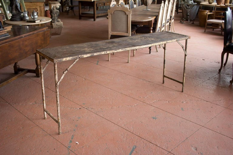 Vintage style industrial folding potting or garden table. Nice distressed surface.