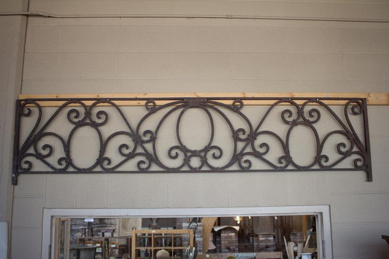 Substantial Arts & Crafts wrought iron transom from Chicago. Beautiful scroll work and patina.