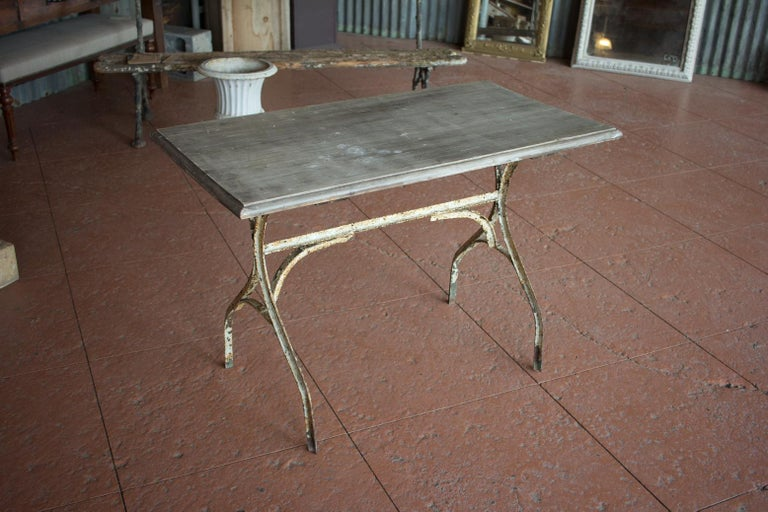 Vintage French bistro table with original painted base and wood top.   Lovely patina to base.