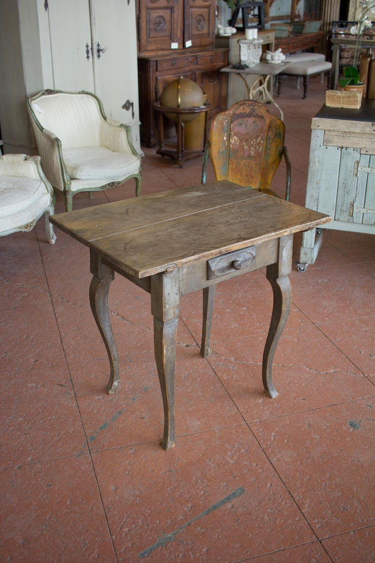 Antique Louis XV rustic side table on cabriole legs, with its original paint. Single drawer to the centre. Beautiful original patina.