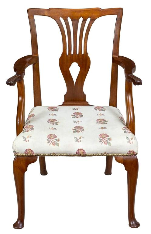 This Queen Anne armchair is supported by well-formed cabriole feet, and note, the rear legs have a desirable stylish camber to them. The legs have had no splices or breaks and are in perfect condition, as is the rest of the chair. The arms are