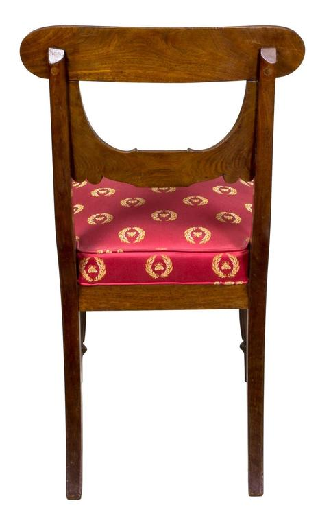 This set of chairs is the only one known with the bulbous reeded front leg and commodious original box seats, which make for a most comfortable and sturdy dining room chair.   The main stylistic theme is the stylized drapery type backsplat which