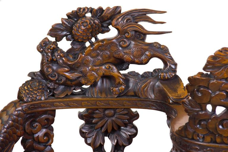 The tête-à-tête form appears in the latter part of the 19th century, a Victorian motif that here is expressed in the Japanese style, and of Japanese workmanship.  This tête-à-tête is a tour de force of the best carving, that is fully developed