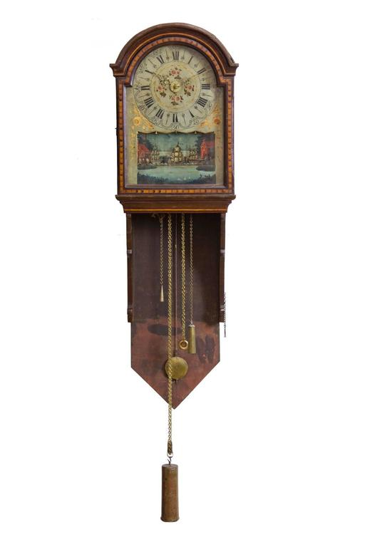 This clock form, unique to Scandinavia, is one of the best and most complicated of the form (see attached basic models). The case has beautiful marquetry throughout, and retains an older historic surface. The beauty of the case complements the
