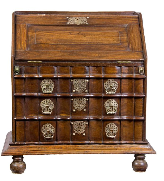 This desk is a tour de force and meant to last forever, circa 1730-1740. It retains its original 18th century bun feet and intricate hardware. All the sides are paneled and the interior is a fully developed amphitheater form, making it the most