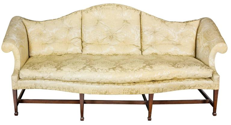 This elegant sofa has fine stylized lines with a serpentine curved front seat rail making for a commodious and comfortable sofa. The arms are carefully scrolled and restrained as is the arching of the back which complements the seat. The legs are
