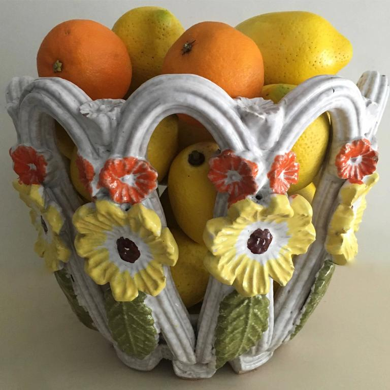An exceptional Majolica terra cotta bowl with flower details the perfect centre piece inside or out or decorative accent to any room. The bold design and colorful flowers make this an outstanding piece.   In perfect condition.