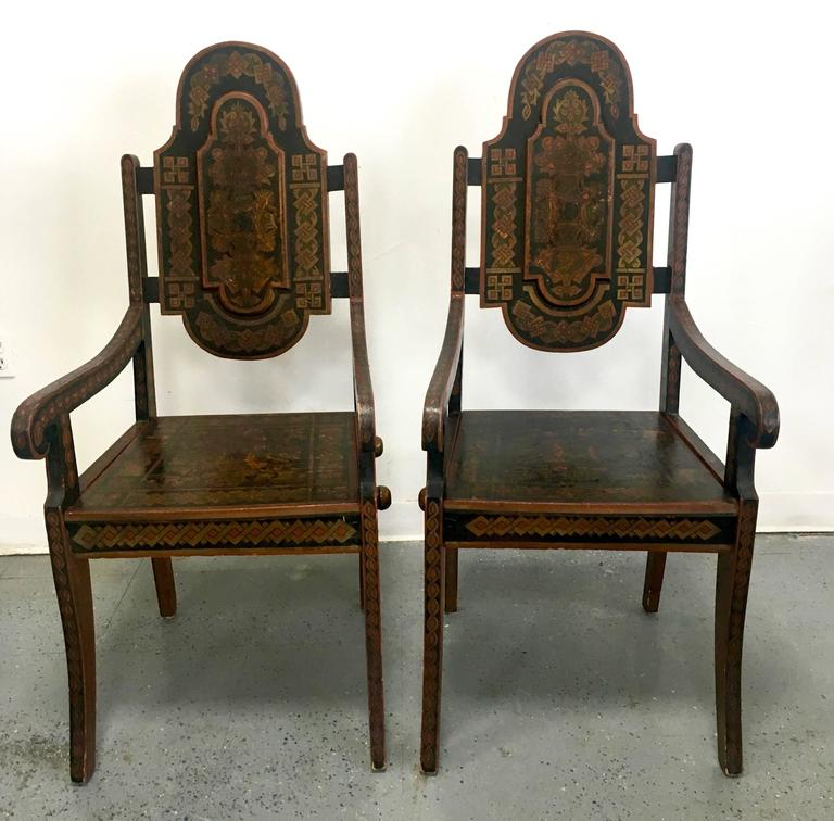 A stunning pair of Moroccan Armchairs - the perfect compliment to an entry, Decorative focal point in an otherwise simple wall... Hand-painted and in very good shape - a handsome pair.  Sturdy enough to use - but we suggest as your new conversation