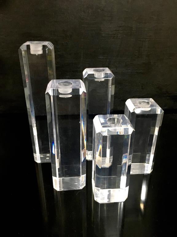 """An important grouping of five Acrylic candlesticks in varying sizes - a stunning focal point for the dining table, console or outside dinner party.  All are 2.5"""" Square and two 6"""", two 8"""" and two 10"""""""