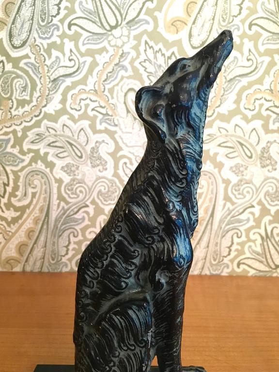 Metal sculpture of afghan Borzoi dog on marble stand. Beautifully made sculpture perfect for the dog, and especially Afghan lover mans best friend sits proudly on any shelf, or desk in any room!