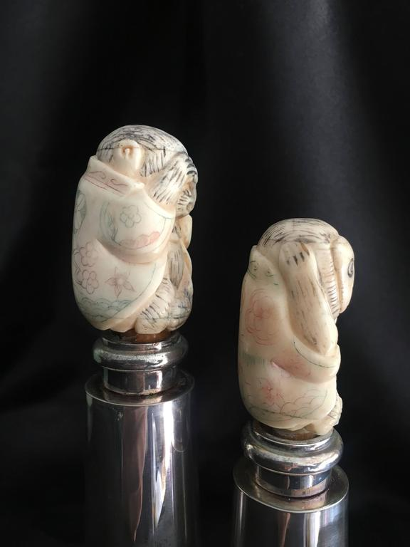 Hans Turnwald Art carved bone salt and pepper shakers / grinders Perfect for the artists table to start any conversation with guests who have a sense of style and ready to chat about Art and Commerce!  The pair grind not shaken sea salt to pepper