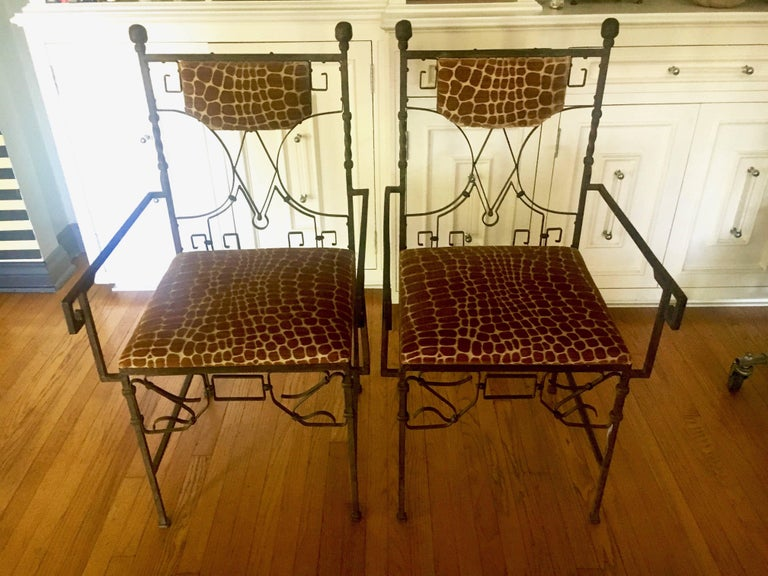An exquisite pair of beautifully designed Art Deco wrought iron upholstered in Rose Tarlow, armadillo, cut velvet.