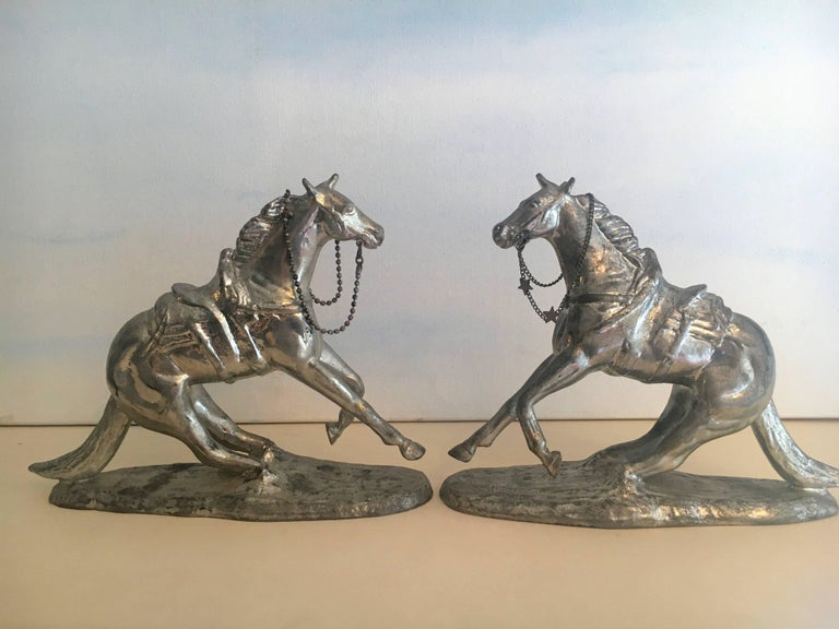 A lovely pair of metal horse bookends with reigns (with stars)... great for any room and any shelf - childrens in particular!