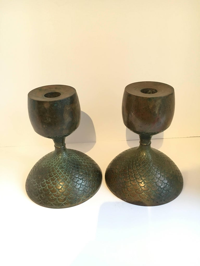 A dynamic and bold Pair of Bonze Candlesticks - the pair have a beautifully etched 'bird like' pattern that graces the base to under the neck of the pieces - hands-down one of the most beautifully patinated finishes we have ever seen - true works of