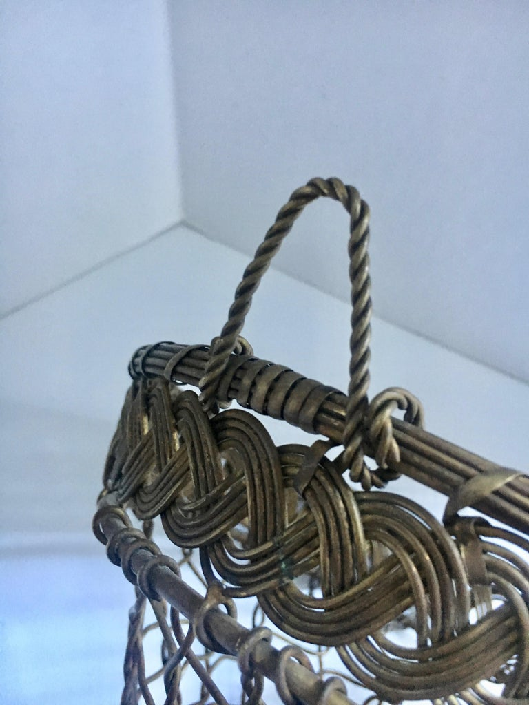 A beautifully made French brass woven wall pocket - one of our favourite pieces.