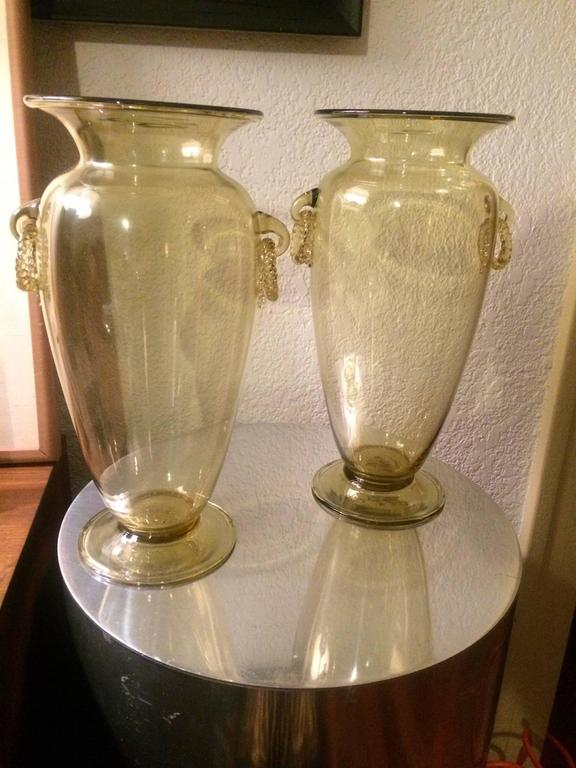This stunning pair of handblown Venetian glass vases are unique in style, quality and color. The Champagne tinted glass with independently blown and rings, are not stationary, but dangle, are exquisitely designed and perfect for the buffet, formal