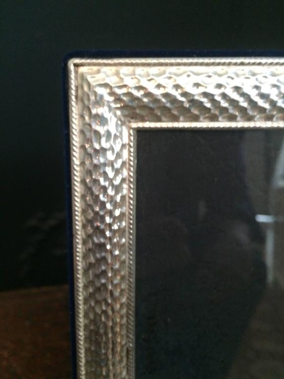5 x 7 sterling frame with beautiful detailed edge. The side and rear are a royal blue velvet. Perfect to display that special someone.