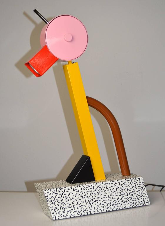 """An iconic """"Tahiti"""" lamp by Ettore Sottsass for Memphis. Capturing the spirit of the Memphis movement, the lamp is composed of metal, wood and laminate in the abstract form of a bird. See Charlotte and Peter Fiell, """"1000 Lights,"""