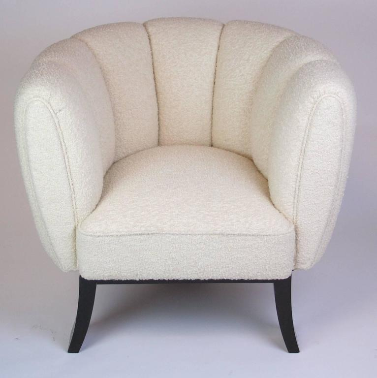 A unique pair of Italian Art Deco club chairs by Guglielmo Ulrich. Ebonized wood tripod base on gently curved and tapered legs. Channel tufted round back. Newly upholstered.