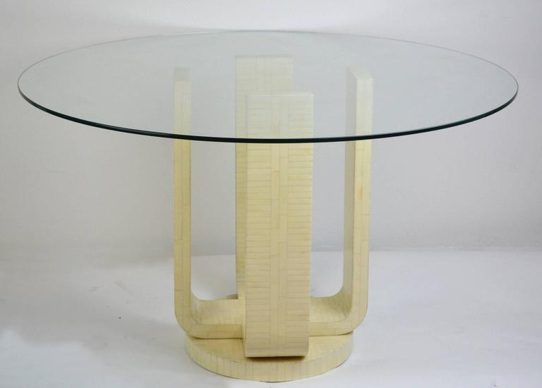 Mid-Century Modern dining or center table base of tessellated bone. Four legs flow down to a circular base. Unmarked but style of Karl Springer and ambiance.