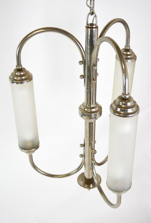 A sculptural chandelier consisting of three arms holding three lit frosted glass tubes. Supremely chic, with a very modern feel. Most likely French, but not documented. Rewired and ready for installation. Height listed does not include chain.