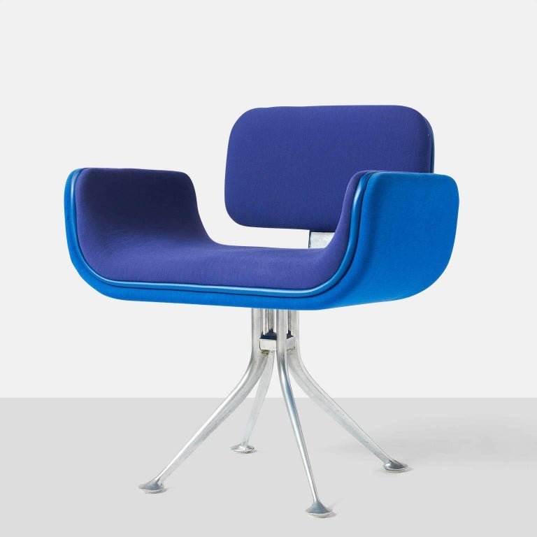 Alexander Girard armchair An armchair by Alexander Girard for Herman Miller. A cast aluminum frame supports an upholstered seat that is shaped in steel and buffered with rubber edging. Upholstery in contrasting blues. Part of the collection that