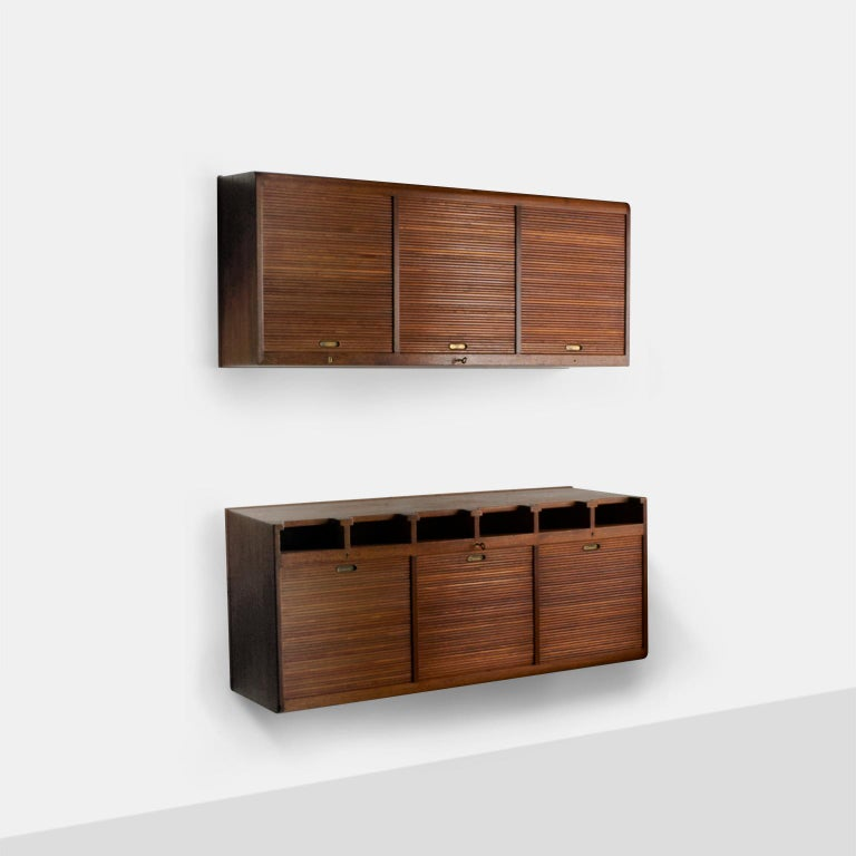 Palle Suenson, two part wall cabinet An extremely rare two part wall hanging cabinet by Danish Architect Palle Suenson in the 1940s. The upper section is divided into three sections tambour doors that roll up and 2 adjustable tray shelves in each