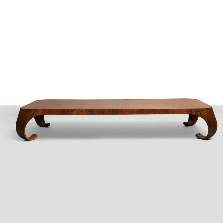 A rosewood coffee table by Isamu Kenmochi. This piece is longer and lower than standard models. Manufactured by Tendo Mokko. Literature: Japanese Modern, Mori, pg. 143.