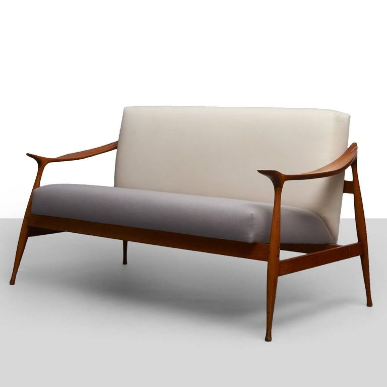 """A """"Lord"""" settee of walnut and upholstery by Ico Parisi for Fratelli Reguitti."""