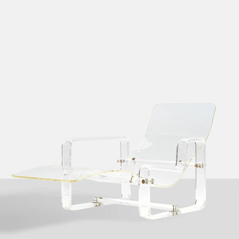 A Lucite chaise with bronze hardware. Two different arm heights allow for different reclining positions. Pre drilled holes so that a cushion can be attached.
