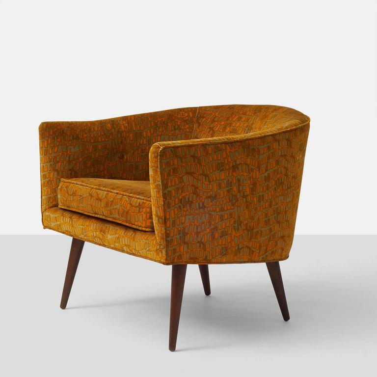 A Milo Baughman tub chair for Thayer Coggin in the original Jack Lenor Larsen velvet fabric. Tapered wooden legs and flared arms.
