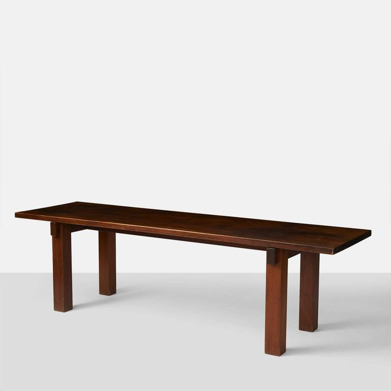 A very rare table in sapele mahogany by Charlotte Perriand which she used personally in her Rio de Janeiro apartment as a console table.