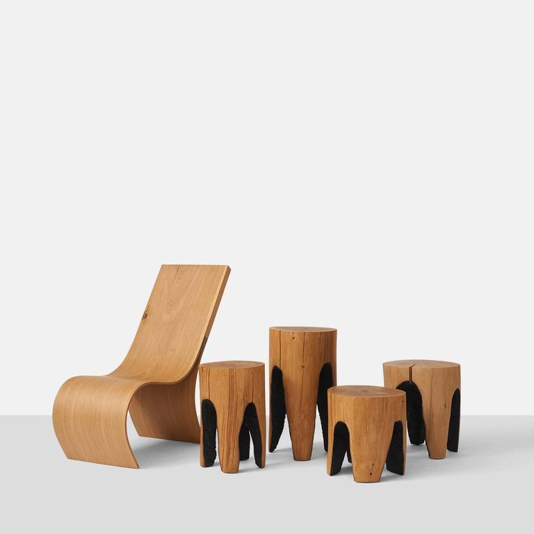 """A collection of stools formed by the hollowing out of oak tree trunks using fire. The oak comes from naturally fallen trees and all are made by the German artist Kaspar Hamacher. Heights vary from 13"""" to 23"""""""