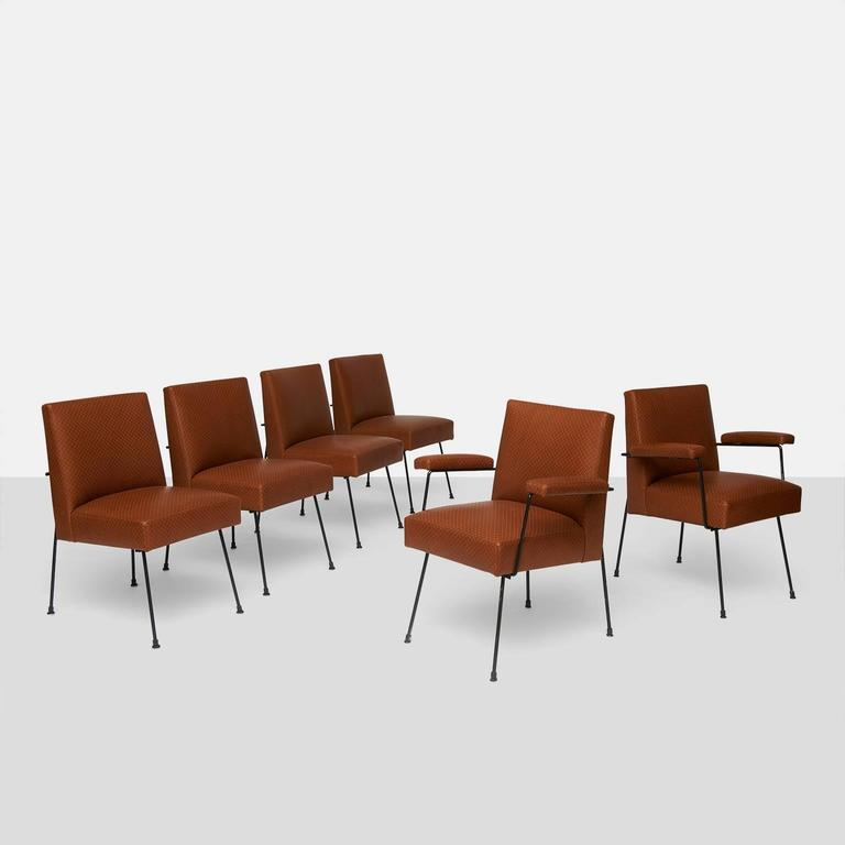 A group of six dining chairs by Milo Baughman for Pacific Iron made in 1950. Two arm and four side chairs with black iron frame and restored using a custom embossed leather from the London company Holland & Sherry with double top stitching