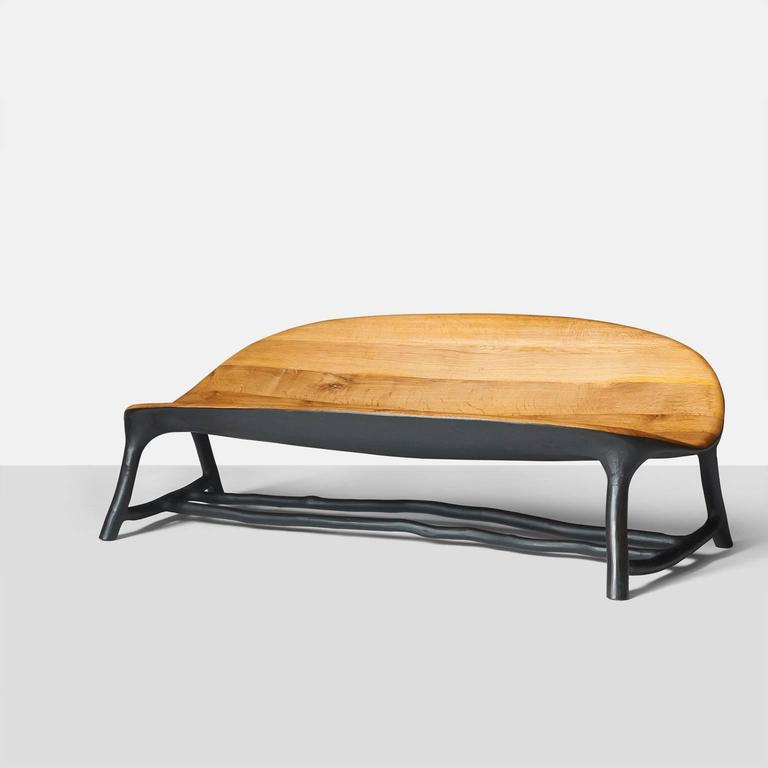 An organic shaped sofa by Valentin Loellmann completely handmade with an oak seat and blackened Hazel branch frame. Each piece is completely handmade by Valentin Loellmann and all are signed and numbered. Valentin Loellmann was an award winner at