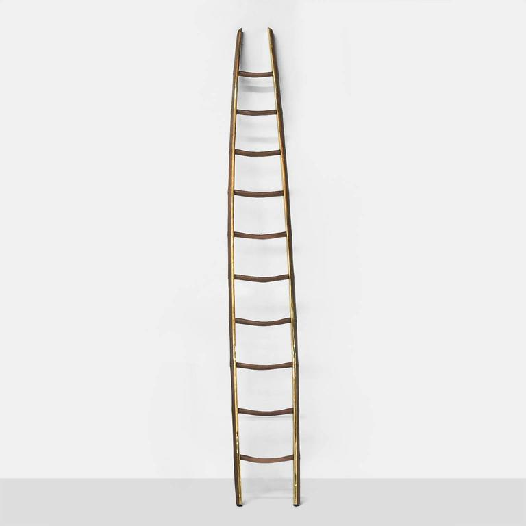 A ladder in brass and black walnut with an organic shape, functional and decorative. Each piece is completely handmade by Valentin Loellmann and all are signed and numbered. Almond & Company is the exclusive gallery representing Valentin's work