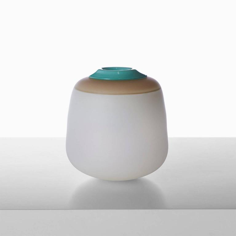 A free handblown glass vase in white and taupe with a green removable glass insert for water by celebrated Paris glass artist Jeremy Maxwell Wintrebert. France, circa 2016. Almond and Co is the exclusive gallery in the US representing this