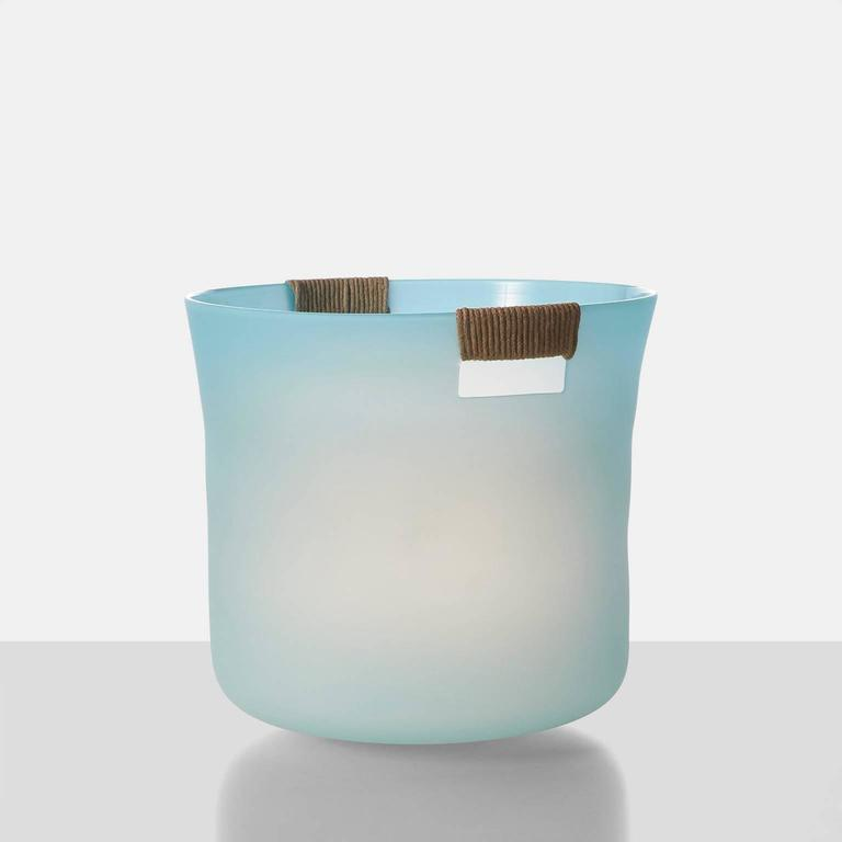 A large-scale free handblown glass vase in ice blue with hemp wrapped handles by noted Parisian glass blower Jeremy Maxwell Wintrebert. Jeremy is a brilliant glass sculptor with worldwide shows and awards.