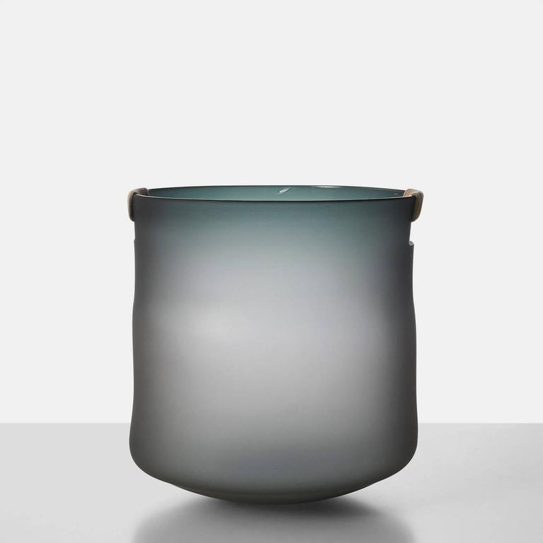 A large-scale free handblown glass vase in gray with hemp wrapped handles by celebrated Paris glass artist Jeremy Maxwell Wintrebert. Almond + Company is the exclusive gallery in the US representing this talented artist.