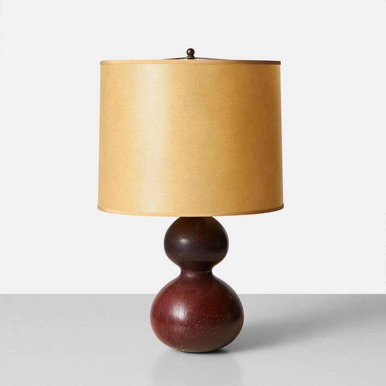 A double gourd shaped table lamp with a glaze in shades of brick and rose. Made by Axel Salto in the Royal Copenhagen studio. Signature etched on the bottom, Denmark, circa 1950.