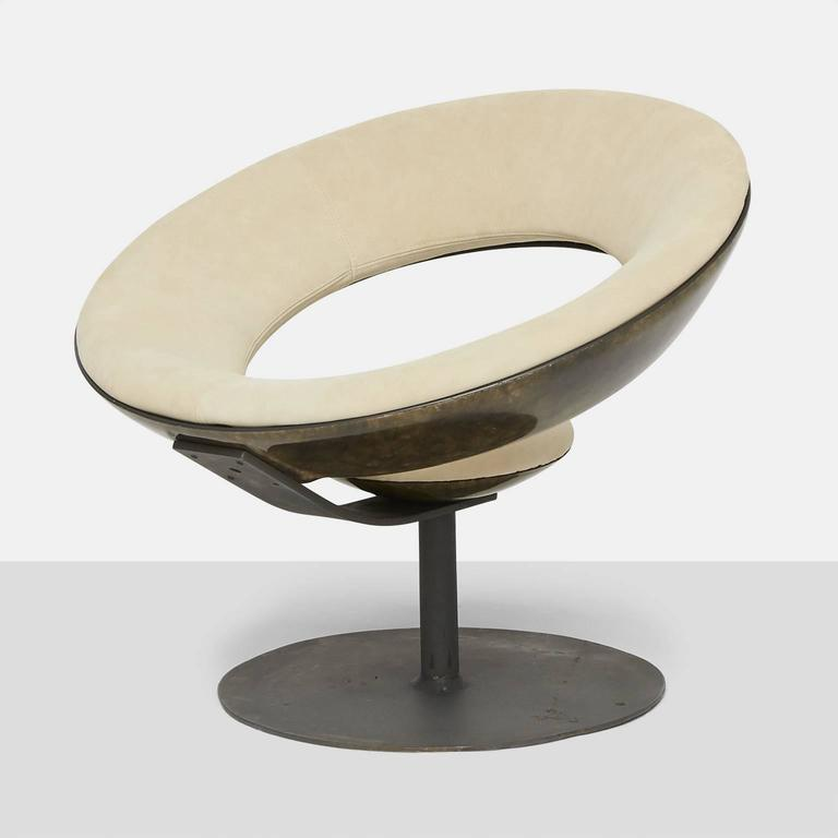 Ricardo Fasanello Anel chair: Enameled steel, suede, fiberglass. This early variation of the Anel chair features an exposed fiberglass frame instead of the more common frame covered in upholstery. Literature: Móvel Brasileiro Moderno, Vasconcellos