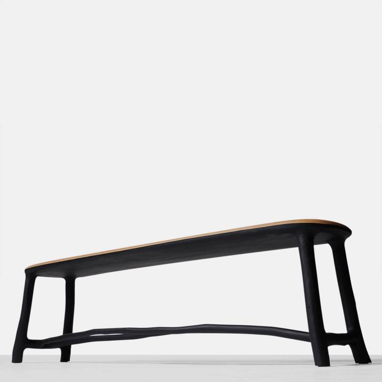 An elegantly proportioned bench in oak with the frame of naturally shaped blackened hazel branches. Each piece is completely handmade by Valentin Loellmann and all are signed and numbered. Each piece is an original work of art. Valentin Loellmann