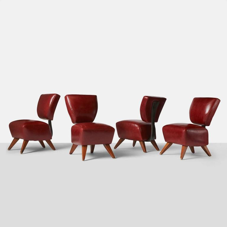 Four rare dining chairs restored in a luxurious red leather and using a molded steel plate running from under the seat to secure the back. The Fred chair was designed for the Barney's Flagship store in NYC,  USA, circa 1990s.
