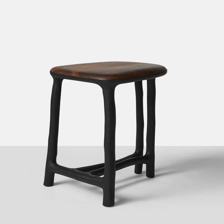 A stool or side table made with hazel branch's that have been blackened with the seat in walnut. Each piece is completely handmade by Valentin Loellmann and all are signed and numbered.