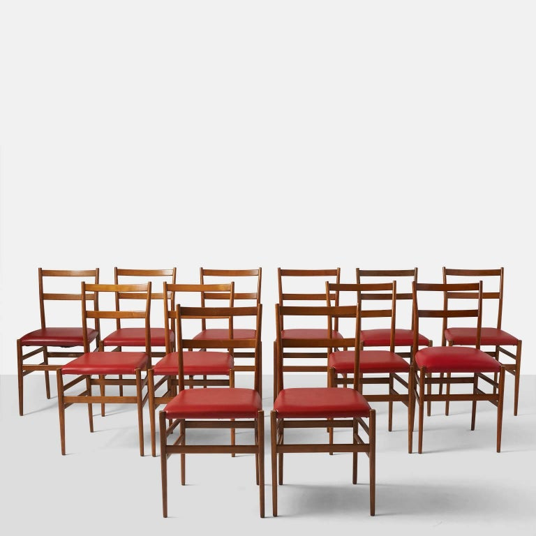 A set of 6 Leggera chairs by Gio Ponti for Cassina retaining the original labels. The seats have been upholstered in a deep red faux leather and the ash is in a medium tone. Note: Chairs are priced and sold as a set of 2 chairs.
