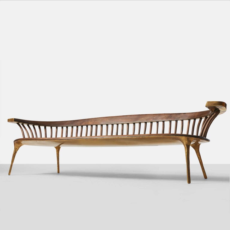 A completely handmade sculptural sofa in solid brass with a walnut seat and back support. All brass work is hand-forged and wood work is hand planed. Valentin Loellmann was an award winner at PAD London for Best Contemporary Design piece.