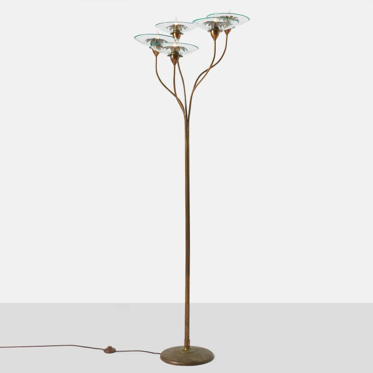 A very rare and documented five-light floor lamp with a floral branch detail in brass with glass bulbash and hand-cut brass leaf rosettes all in a rich natural aged brass patina Documented in the book