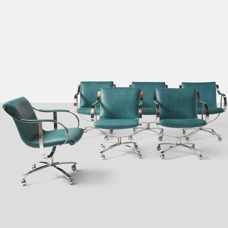 A set of six swivel chairs series #455 restored in a blue leather on chromed steel frames and four castered legs. USA, circa 1970s.